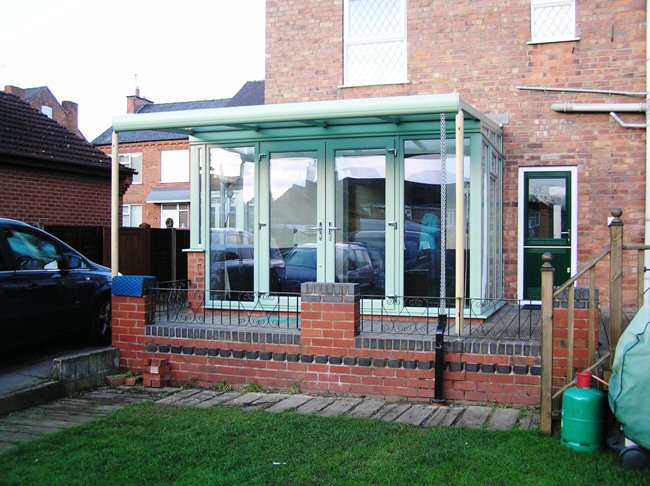 replacement conservatory in green upvc