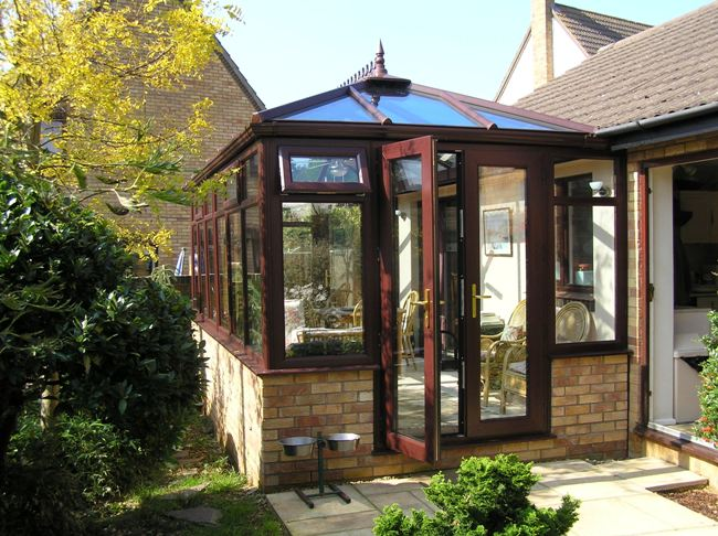replacement conservatory in woodgrain upvc